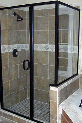 Framed glass shower enclosure